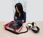 Japanese woman and music player — Stock Photo
