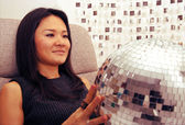 Japanese woman holds glitterball — Stock Photo