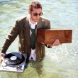Dj in sea - Stockfoto