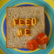 Feed me words on toast — Stock Photo