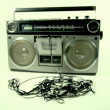Tape spewing boombox - Stock Photo