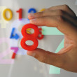Hand holding the number eight — Stock Photo #12797013