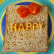 Happy word on toast — Stock Photo