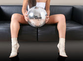 Woman's legs and discoball — Stock Photo