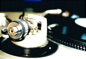 A record turntable with the needle in focus — Stock Photo
