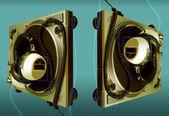 Large retro headphones on a turntable — Stock Photo