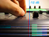 Hand controlling faders — Stock Photo