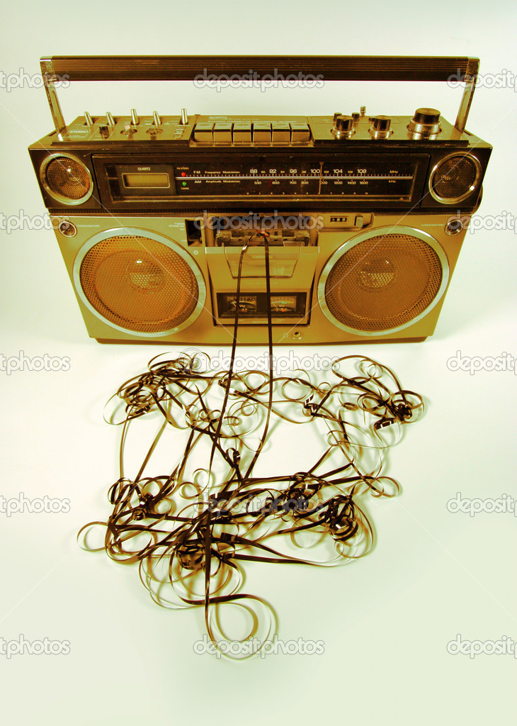 Cassette tape spewing out of a retro ghettoblaster — Stock Photo #12795418