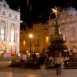 Crowds at night around the Eros statue - Stock Photo
