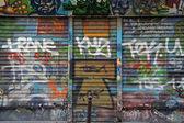 Graffiti covered shop — Stock Photo