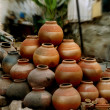 Clay plant pots stacked in a pyramid - Stock Photo