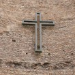 Cross on wall - Stock Photo