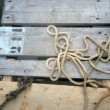 Rope on pier - Stock Photo