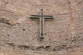 Cross on wall — Stock Photo