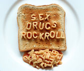 Sex drugs rock roll toast — Stock Photo