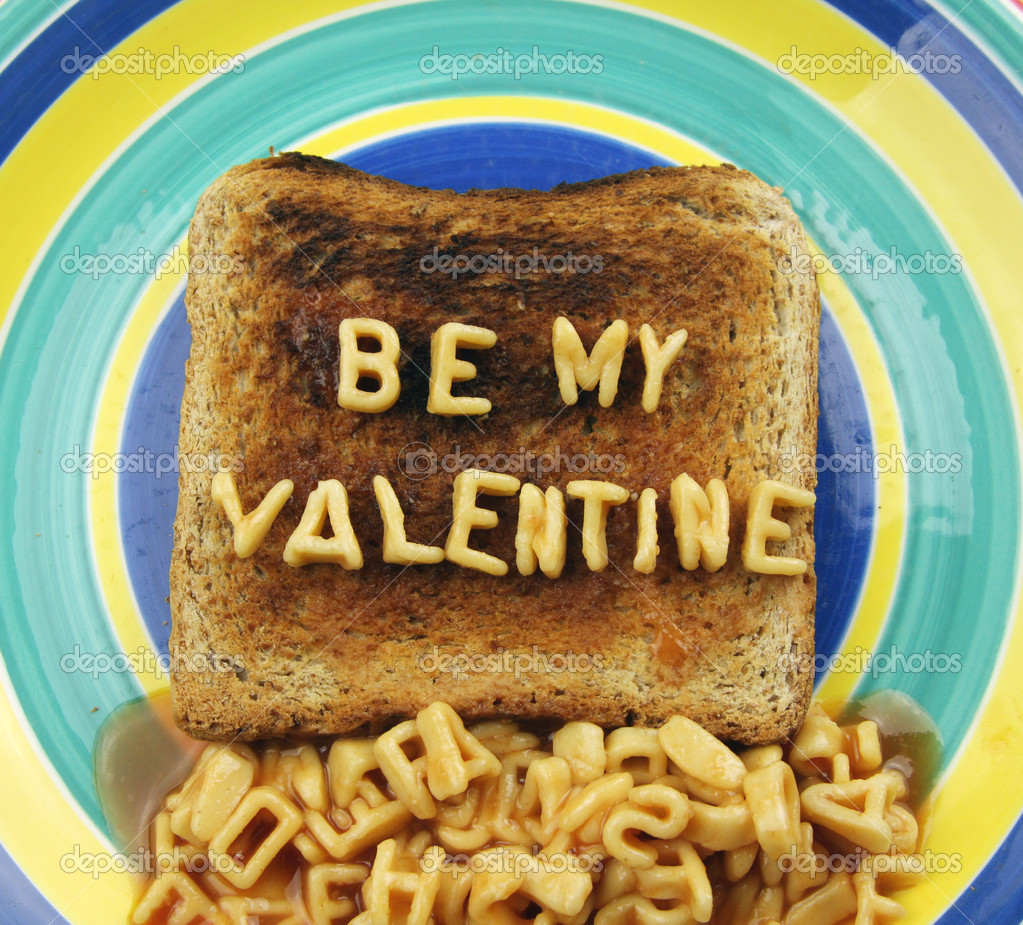 The words be my valentine, spelled out with spaghetti letters  Stock Photo #12814593