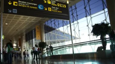 Rushing around the terminal at barcelona airport
