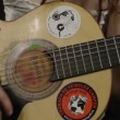 Cool gypsy style woman plays guitar — Stock Video