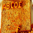 Alphabet stop motion animation with spaghetti letters on toast - Stock Photo