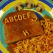 Alphabet stop motion animation with spaghetti letters on toast — Stockvideo