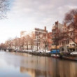 A shot of canal and street scene in amsterdam - Stock Photo