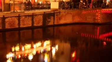 Reflection in canal of red light district neon lights , amsterdam — 图库视频影像