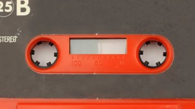 Sequence made from close up shots of cassette music tapes — Stock Video