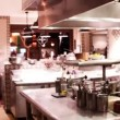 Stockvideo: Timelapse shot of chefs preparing food in busy hotel restaurant kitchen