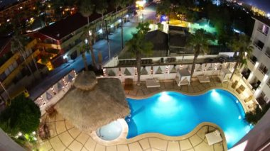 Timelapse at night looking down onto a luxury swimming pool in a boutique hotel — Stock Video