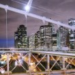 Timelapse of lower manhattan shot from brooklyn bridge at night, new york — Stock Video