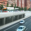 Panning timelapse nighttime traffic shot from a bridge in barcelona spain - Stock Photo