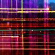 Abstract pattern made from timelapse traffic and street scene shot at night - Stock Photo