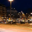 A pan across a street scene at dusk in barcelona , spain - Stock Photo