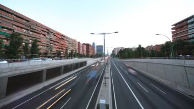 Panning timelapse nighttime traffic shot from a bridge in barcelona spain — Stock Video