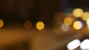 Panning timelpase and out of focus abstract shot of traffic in barcelona spain at night — Video Stock