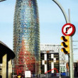Stock Video: Shot of the torres agbar building in barcelona and traffic on the roads