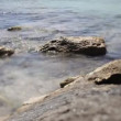 Lapping of water crashing on rocks — Stock Video