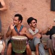 Drummers play on benirras beach in ibiza as sunset starts.  — Stock Video