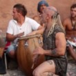 Drummers play on benirras beach in ibiza as sunset starts. - Stock Photo