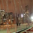 Timelapse of brooklyn bridge at night, new york - Stock Photo