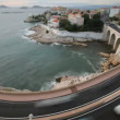 Stock Video: Long exposure time-lapse shot of traffic on bend in corniche road, marseilles