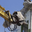 A crane breaking down a building, looking a bit like like a dinosaur eating! — Stock Video #16647127