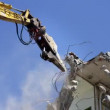 A crane breaking down a building, looking a bit like like a dinosaur eating! — Stock Video #16647191