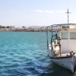 Stock Video: Fishing boat and small port in crete, greece