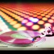 Dj record turntable with blurred disco scene in background — Stock Video