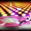 Dj record turntable with blurred disco scene in background — Stockvideo