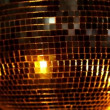 A funky discoball spinning and reflecting light — Stock Video #16779307
