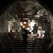 A funky discoball spinning and reflecting light — Stock Video #16779395