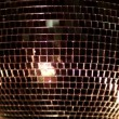 A funky discoball spinning and reflecting light — Stock Video #16779403