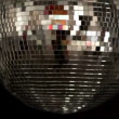 A funky discoball spinning and reflecting light — Stock Video #16779471